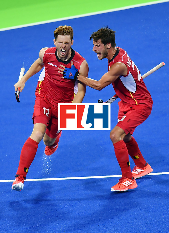 Belgium's Gauthier Boccard (L) celebrates a goal with Belgium's Elliot van Strydonck during the men's Gold medal field hockey Belgium vs Argentina match of the Rio 2016 Olympics Games at the Olympic Hockey Centre in Rio de Janeiro on August 18, 2016. / AFP / MANAN VATSYAYANA        (Photo credit should read MANAN VATSYAYANA/AFP/Getty Images)