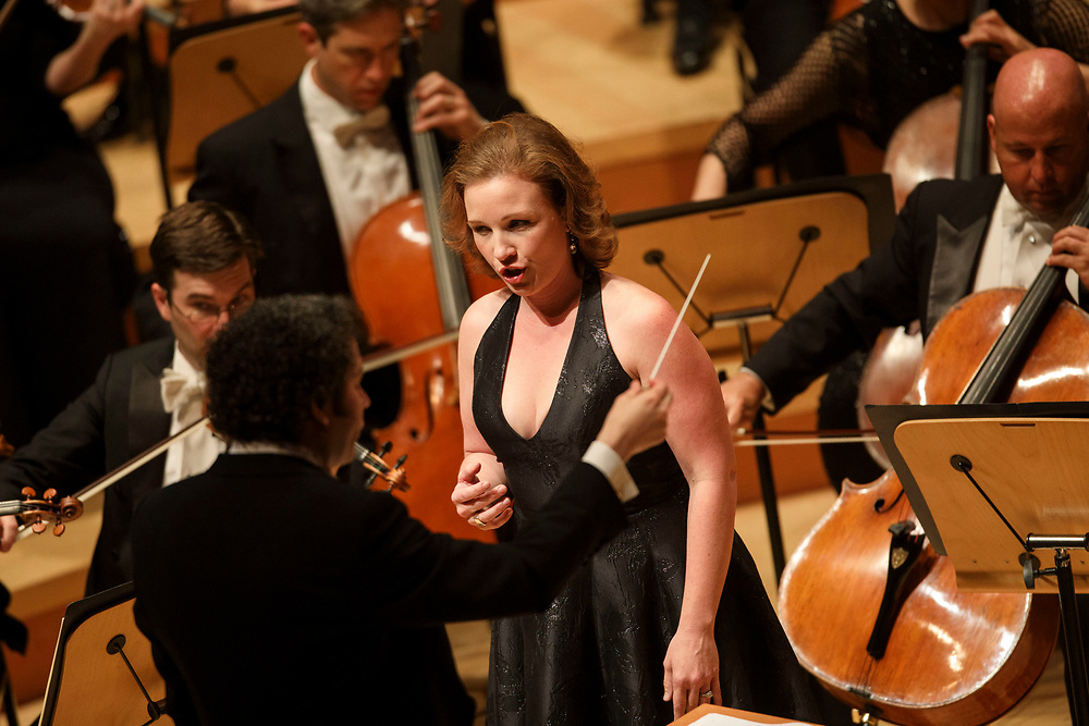 Mezzo-soprano Sasha Cooke sings as Gustavo Dudamel conducts during the LA Philharmonic at the Walt Disney Concert Hall on Thursday, May 18, 2017 in Los Angeles, Calif. The evening's performance featured Gustavo Dudamel's Schubert symphony as well as a tribute to outgoing president Deborah Borda, followed by a solo vocal from mezzo-soprano Sasha Cooke. © 2017 Patrick T. Fallon