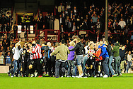 London - Tuesday, 21st September, 2010: Brentford fans surround the Brentford team after victory in the Carling Cup 3rd Round match at Griffin Park, London...Pic by: Alex Broadway/Focus Images