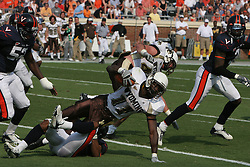 Virginia cornerback Tony Franklin (23) tackles Wyoming running back Devin Moore (11).  The Virginia Cavaliers defeated the Wyoming Broncos 13-12 in overtime on September 9, 2006 at Scott Stadium in Charlottesville, VA.