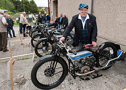 "© Licensed to London News Pictures. 24/05/2015. Warmley, South Gloucestershire UK.  Picture of Bill Douglas, great grandson of the founders of Douglas Motorcycles at the annual rally of vintage Douglas Motorcycles at Kingswood Heritage Museum.  The world famous Douglas bikes were built in Kingswood from 1907 to 1957. Some 25000 were constructed for military use in the First World War. The bikes were regular winners of the Isle of Man TT races. Bill Douglas, great grandson of the founders of the firm, said: ""It is always a stirring sight to see the bikes in action, and we expect a big turnout around the area to watch the cavalcade"". Photo credit : Simon Chapman/LNP"