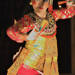 A Balinese traditional dancer performs during a traditional Barong performance.