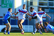 Pauli Pauli of Wakefield Trinity on the attack against Ben Johnston (L) and Jordan Syme (R) Halifax RLFC during the Pre-season Friendly match at Belle Vue, Wakefield<br /> Picture by Stephen Gaunt/Focus Images Ltd +447904 833202<br /> 07/01/2018