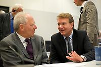DEU, Deutschland, Germany, Berlin, 13.12.2011:<br />Bundesfinanzminister Wolfgang Sch&auml;uble (CDU) im Gespr&auml;ch mit Kanzleramtsminister Ronald Pofalla (CDU) vor Beginn der CDU/CSU-Fraktionssitzung im Deutschen Bundestag.