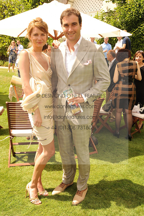 DAVID & GABRIELLA PEACOCK at a luncheon hosted by Cartier for their sponsorship of the Style et Luxe part of the Goodwood Festival of Speed at Goodwood House, West Sussex on 4th July 2010.