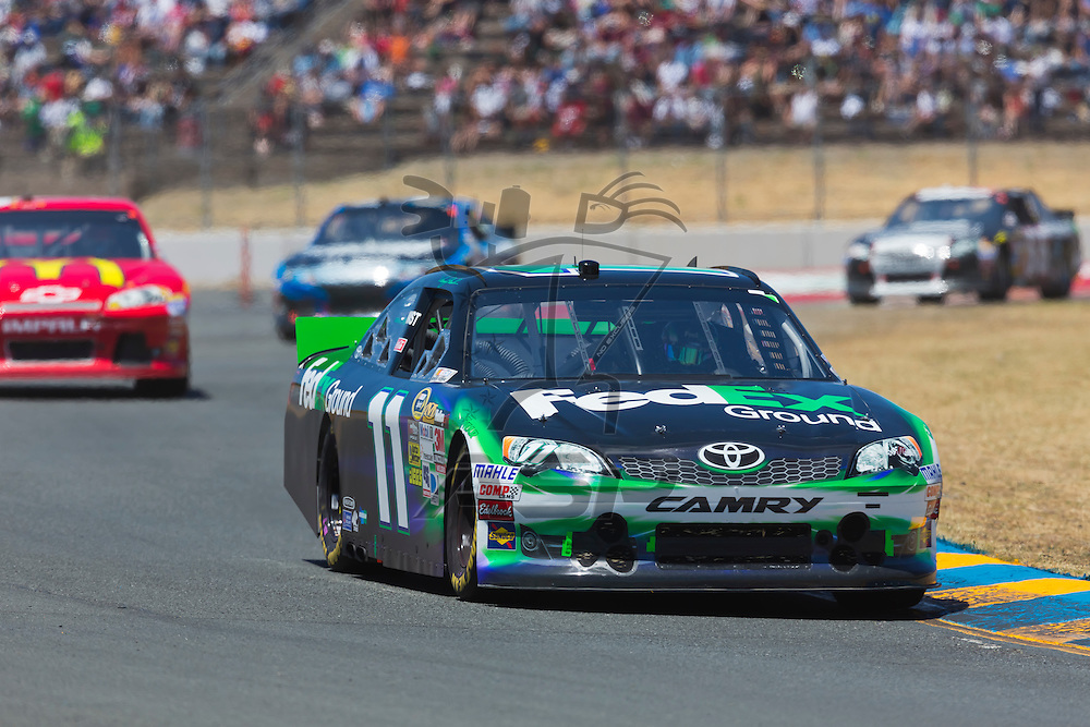 SONOMA, CA - JUN 24, 2012:  Denny Hamlin (11) brings his car through the turns during the Toyota Save Mart 350 at the Raceway at Sonoma in Sonoma, CA.