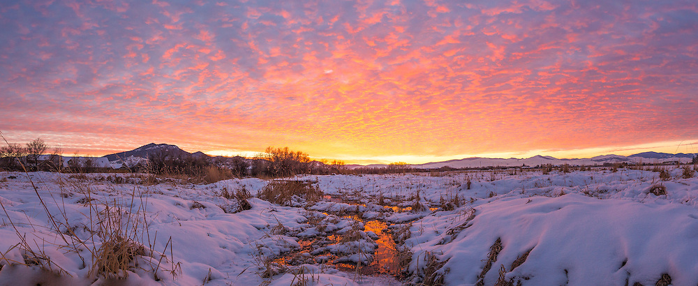 A beautiful sunset illuminates the sky over the Helena Valley on New Years Eve, 2015.