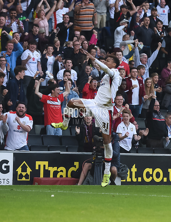 Milton Keynes Dons midfielder Josh Murphy celebrates his goal after making it 1-1 during the Sky Bet Championship match between Milton Keynes Dons and Derby County at stadium:mk, Milton Keynes, England on 26 September 2015. Photo by David Charbit.