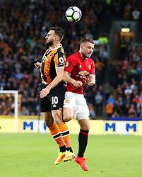 Robert Snodgrass of Hull City challenges Eric Bailly of Manchester United  - Mandatory by-line: Matt McNulty/JMP - 27/08/2016 - FOOTBALL - KC Stadium - Hull, England - Hull City v Manchester United - Premier League