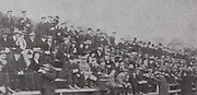 Scenes from the Munster final of 1907 between Cork and Tipperary, which was played in Fermoy. Cork won by 1-6 to 1-4. The photo shows some musicians entertaining the crowd with money being collected.