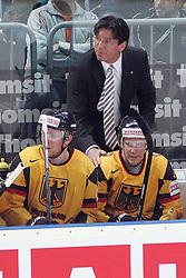 20.05.2010, SAP-Arena, Mannheim, GER, 74. IIHF WM, Gruppe D, Schweiz ( SUI ) vs Deutschland ( GER ) im Bild: Uwe KRUPP Headcoach / Cheftrainer of Team Germany / Deutschland spricht mit Marcel MUELLER ( GER / Koeln #25 ) und Christoph ULLMANN ( GER / Koeln #47 ) EXPA Pictures © 2010, PhotoCredit: EXPA/ nph/   Florian Mueller / SPORTIDA PHOTO AGENCY