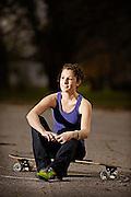 Kyla kemp with her longboard in Vermillion, SD.