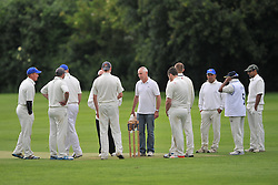 ROTHWELL GET READY TO FIELD AFTER HEAVY RAIN, ROTHWELL CRICKET CLUB v  NORTHAMPTON SAINTS  CC, Desborough  Road Rothwell  Saturday 25th June 2016