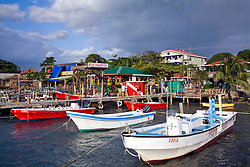 Roatan, Honduras:  West End Divers wharf in West Bay, the commercial settlement at the far eastern end of this barrier island off the north coast of Honduras.