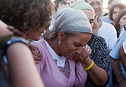 Iris Yifrah , the mother of  Eyal Yifrah mourns by her son's grave during the funerals of  the three  Israeli teenagers who were abducted  June 12th weeks  during their joint funeral in Modiin, Israel, July 1, 2014. Thousands  of mourners attended the  funeral service for Eyal Yifrah,  Gilad Shaar, and Naftali Fraenkel,the three Israeli teenagers found dead iby IDF forces near the West Bank city of Hebron after weeks of  searching  . Israel has accused Hamas militant group although Hamas claims no responsibility .(Photo by Heidi Levine /Sipa Press). young men