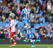 Joao Carlos Teixeira, Brighton midfielder scores a goal during the Sky Bet Championship match between Brighton and Hove Albion and Birmingham City at the American Express Community Stadium, Brighton and Hove, England on 21 February 2015.
