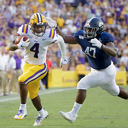 Aug 31, 2019; Baton Rouge, LA, USA; LSU Tigers running back John Emery Jr. (4) runs past Georgia Southern Eagles linebacker Randy Wade Jr. (47) during the first quarter at Tiger Stadium. Mandatory Credit: Derick E. Hingle-USA TODAY Sports