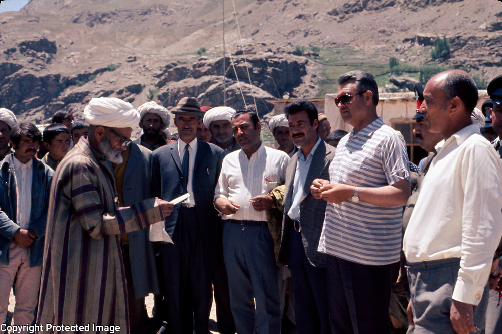 3 June 1976<br /> Taj Mohd. Wardak (center in sports shirt), Governor of Badakhshan province, opening a cooperative. Local poet reads welcome address.
