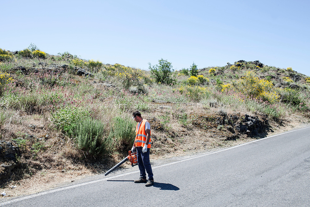 29 May 2017, San Vito, Ercolano, Naples Italy - Street cleaner on the road to Vesuvius near the blocks of lava.