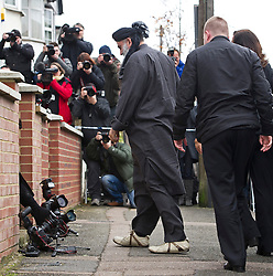 © London News Pictures. 13/11/2012. London, UK. Radical Preacher Abu Qatada (centre) arriving at his bail home in London in front of the media after being released from prison following a successful appeal against his extradition to Jordan where he was convicted of terror charges in his absence in 1999. Photo Credit: Ben Cawthra/LNP