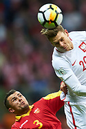 Warsaw, Poland - 2017 October 08: (R) Lukasz Piszczek of Poland fights for the ball with (L) Vladimir Jovovic of Montenegro during soccer match Poland v Montenegro - FIFA 2018 World Cup Qualifier at PGE National Stadium on October 08, 2017 in Warsaw, Poland.<br /> <br /> Mandatory credit:<br /> Photo by © Adam Nurkiewicz / Mediasport<br /> <br /> Adam Nurkiewicz declares that he has no rights to the image of people at the photographs of his authorship.<br /> <br /> Picture also available in RAW (NEF) or TIFF format on special request.<br /> <br /> Any editorial, commercial or promotional use requires written permission from the author of image.
