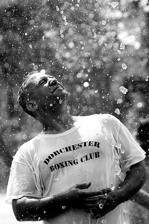 07/07/2013 -- BOSTON -- Jeff Shaw, of Holyoke, cools off at the Rose Kennedy Greenway fountain on July 7, 2013. Shaw, a mover, just wrapped up a cross-country move from the west coast, which he will repeat in 2 days. (Boston Herald Photo by Kelvin Ma)