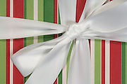 extreme close up of a gift wrap present with a white bow
