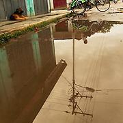 Trishaw reflection at downtown Nyaungshwe