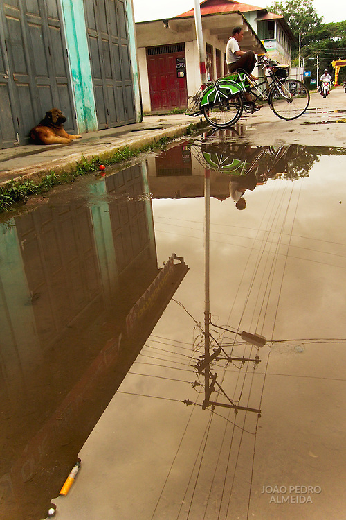 Trishaw reflection at downtown Nyaungshwe