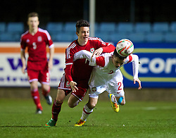 RHYL, WALES - Tuesday, March 18, 2014: Wales' Sam Phillips in action against Poland's Patryk Romanski during the Under-15's International Friendly match at Belle Vue. (Pic by David Rawcliffe/Propaganda)
