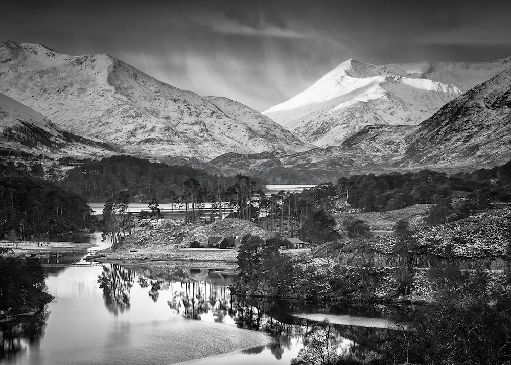 An chill and atmospheric morning in Glen Affric, looking down Loch Affric and watching the first light begin to catch around the peak of Beinn Fhada.