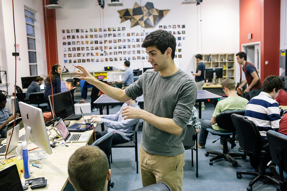 Members of Startup Shell, including senior Nick Aversano, center, work on various projects at the Startup Shell headquarters on the University of Maryland campus on April 1, 2015. Startup Shell is a not for profit company run entirely by and for students at UMD. Entrepreneurial students from all different disciplines apply to join and if accepted, can work on their innovative project with others collaborating and teaching one another.