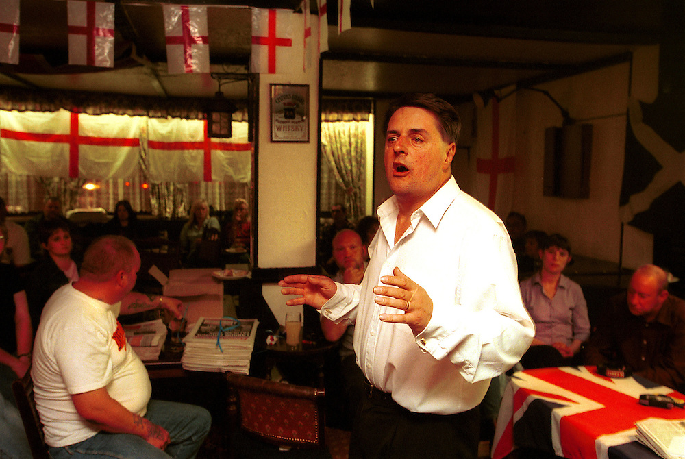 BNP (British National Party) supporters fill a pub in Princes End, near Dudley in the West Midlands, to hear their local candidate John Salvage and BNP Chairman Nick Griffin(right) speak, urging supporters to get out and vote in the Local Council Elections of May 2nd. Photo shows Nick Griffin talking to a supporters..