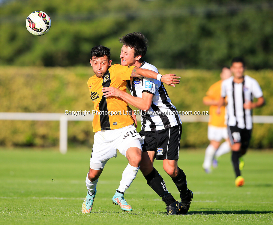 Wellington's Luis Corrales and Sean Liddicoat compete for a ball. Hawkes Bay United v Wellinton, Semi final leg 1, ASB Premiership football, Park Island, Napier, New Zealand. Saturday, 21 March, 2015. Copyright photo: John Cowpland / www.photosport.co.nz