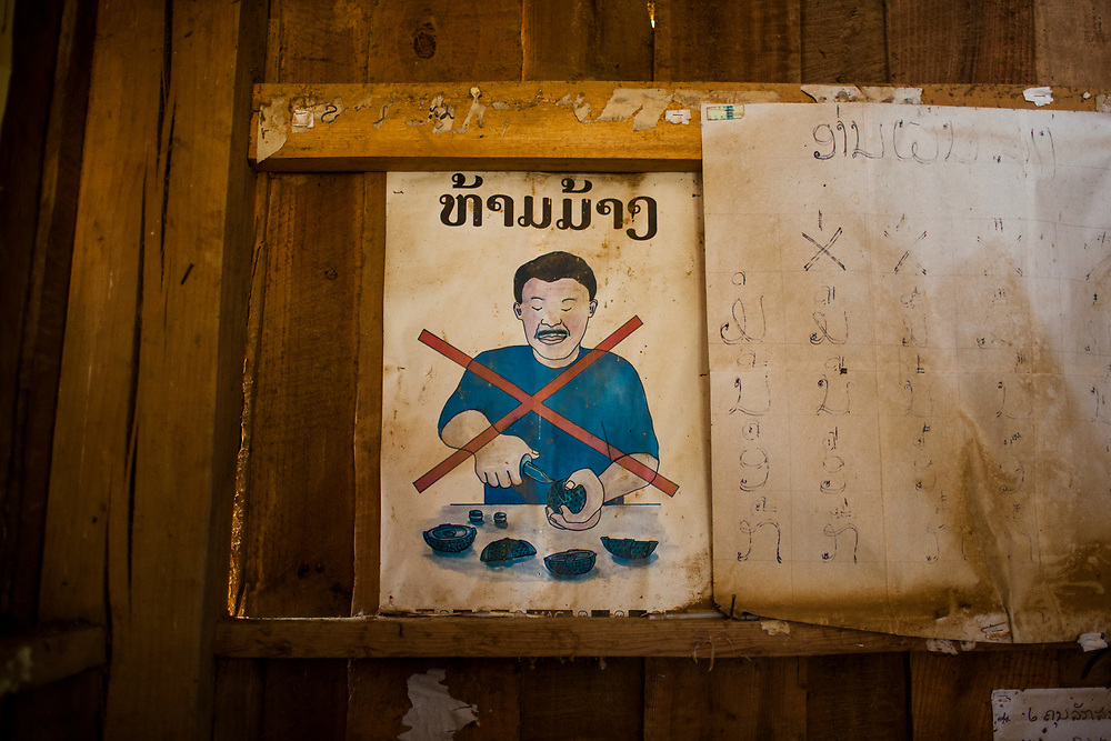 A sign at the local elementary school warning of the dangers of dismantling old bombs. Xieng Khouang province was heavily bombed and mined during the Vietnam-American War.