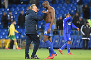 Cardiff City first team manager Neil Warnock celebrates the win with Cardiff City defender Souleymane Bamba (14) 3-1 during the EFL Sky Bet Championship match between Cardiff City and Norwich City at the Cardiff City Stadium, Cardiff, Wales on 1 December 2017. Photo by Alan Franklin.