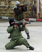 EDITORS NOTE: THIS IS A SEQUENCE.Palestinian gunmen shooting towards Israeli tanks and forces in the center of Ramallah Friday March 29,2002. The gunman with the Kafiya was shot by Israeli forces. (Photo by Heidi Levine/Sipa Press).