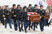 A U.S. Army honor guard carries the casket of  Pfc. Aaron Nemelka, during a burial ceremony at Camp Williams, Saturday Nov. 14, 2009 in Riverton, Utah. Nemelka was one of 13 gunned down at Fort Hood, Texas. (AP Photo/Colin Braley)