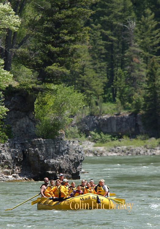 Tourists on commercial rafts make their way through the Lunch Counter rapids on the Sanke River in Wyoming.