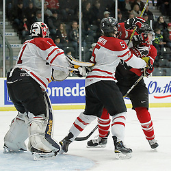 COBOURG, - Dec 16, 2015 -  Game #9 - Canada East vs Canada West at the 2015 World Junior A Challenge at the Cobourg Community Centre, ON. Adam Smith #5 of Team Canada East battles in front of the net during the second period<br /> (Photo: Amy Deroche / OJHL Images)