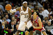 Apr 19, 2010; Cleveland, OH, USA; Cleveland Cavaliers forward LeBron James (23) faces-off against Chicago Bulls guard Kirk Hinrich (12) during the fourth period in game two in the first round of the 2010 NBA playoffs at Quicken Loans Arena. The Cavaliers beat the Bulls 112-102. Mandatory Credit: Jason Miller-US PRESSWIRE