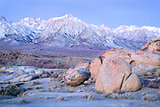 Winter Sunrise on Red Granite Boulders and the Sierra Nevada Mountains, CA.