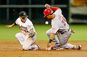 July 24, 2012; Houston, TX, USA; Cincinnati Reds outfielder Xavier Paul (26) beats the throw to Houston Astros second baseman Jose Altuve (27) during the second inning at Minute Maid Park. Mandatory Credit: Thomas Campbell-US Presswire