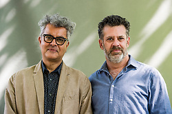 Pictured: Amitava Kumar and Michael Redhill <br /> <br /> Amitava Kumar(born 17 March 1963)is an Indian writer and journalist who is Professor of English on the Helen D. Lockwood Chair at Vassar College.<br /> <br /> Michael Redhill is an American-born Canadian poet, playwright and novelist. He also writes under the pseudonym Inger Ash Wolfe.