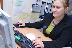 Polish office worker using the computer at work,