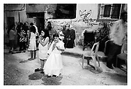 A young girl in party dress is celebrating during an engagement party in Aida refugee camp. Bethlehem, Palestine, 2007