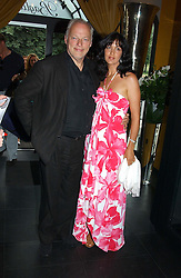 Musician DAVE GILMOUR and his wife writer POLLY SAMPSON at Tatler Magazine's Summer Party held at the Baglioni Hotel, 60 Hyde Park Gate, London SW7 on 1st July 2004.