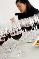 23 July, 2008. New York, NY. Wine director Belinda Chang of The Modern restaurant tastes of the 25 Cotes-du-Rhone at a wine panel that takes place at the New York Times building.  The wine panel is composed of New York Times chief wine critic Eric Asimov, New York Times food writer Florence Fabricant, wine director Chris Goodhart of the Balthazar restaurant, and wine director Belinda Chang of The Modern restaurant. <br /> <br /> &copy;2008 Gianni Cipriano for The New York Times<br /> cell. +1 646 465 2168 (USA)<br /> cell. +1 328 567 7923 (Italy)<br /> gianni@giannicipriano.com<br /> www.giannicipriano.com