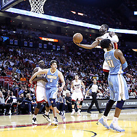 19 March 2011: Miami Heat shooting guard Dwyane Wade (3) goes for the layup against Denver Nuggets center Nene Hilario (31) during the Miami Heat 103-98 victory over the Denver Nuggets at the AmericanAirlines Arena, Miami, Florida, USA.