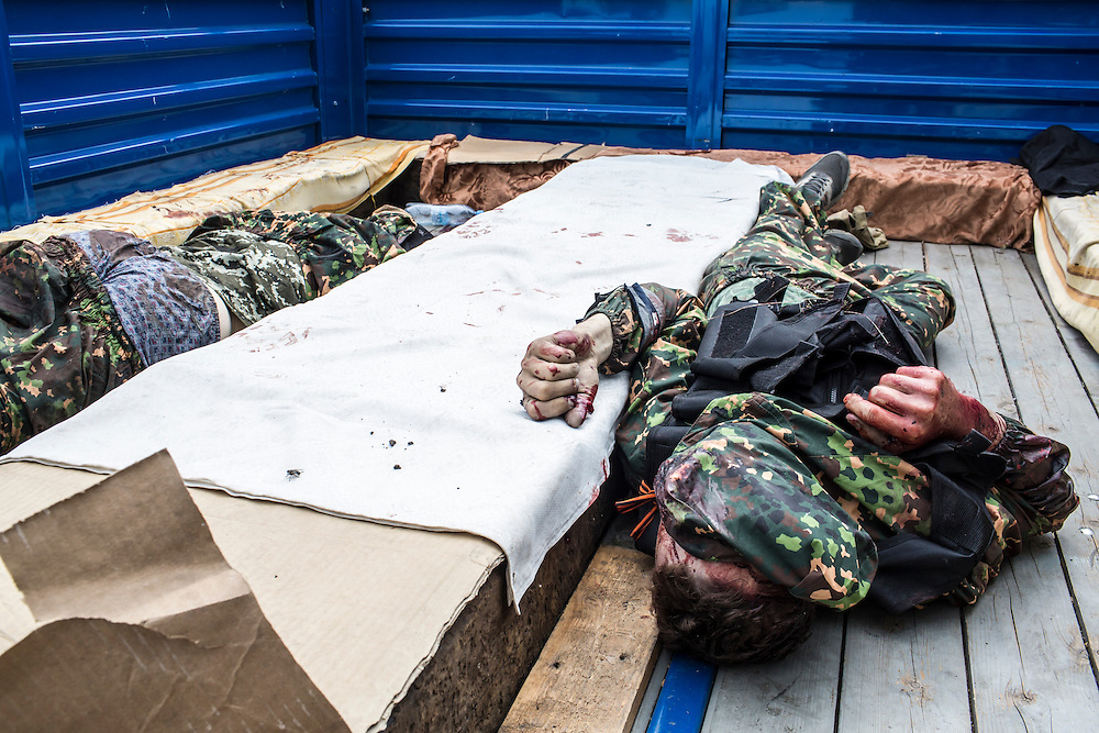 PISKY, UKRAINE - MAY 23: The bodies two fighters from the Vostok Battalion, a pro-Russia militia, lie in the bed of a truck on May 23, 2014 in Pisky, Ukraine. At least eight people between the two sides, including one civilian, were killed in an early morning firefight when the Donbass Battalion, a pro-Ukraine militia, attacked a Vostok Battalion checkpoint in the nearby town of Karlivka. (Photo by Brendan Hoffman/Getty Images) *** Local Caption ***